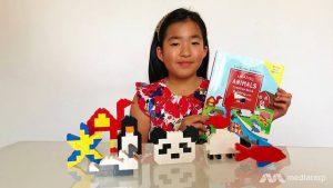 Cô bé 9 tuổi xuất bản sách cho em bị bệnh Down